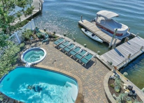 Bayfront Updated 4.5 Bed 3 Bath!  Heated Pool & Tub, Decks, Wolf Range